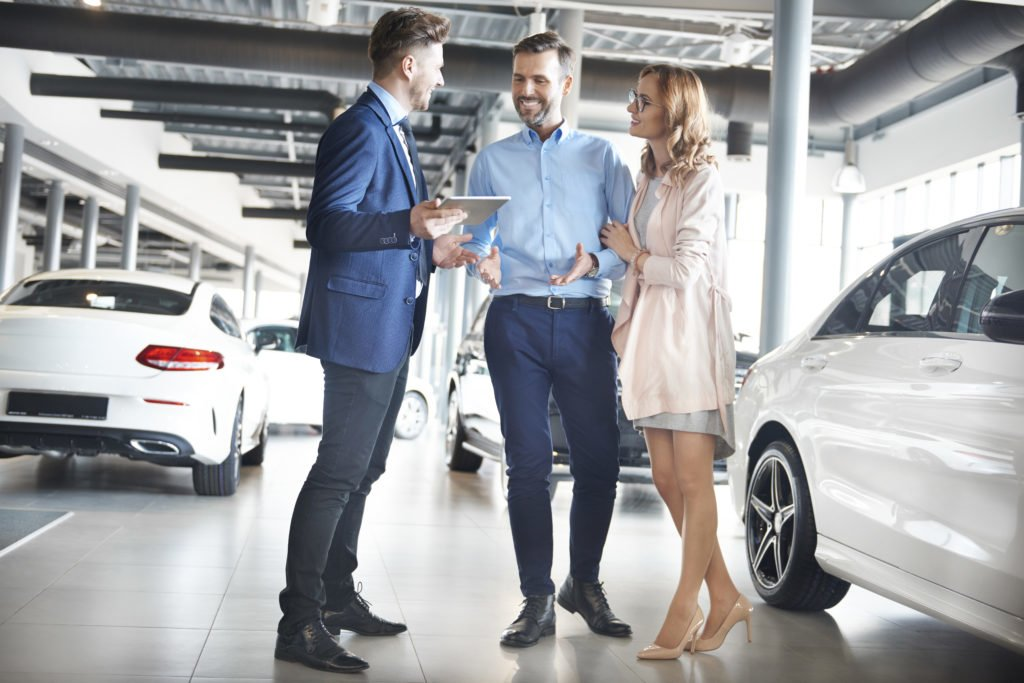 Couple purchasing brand new car